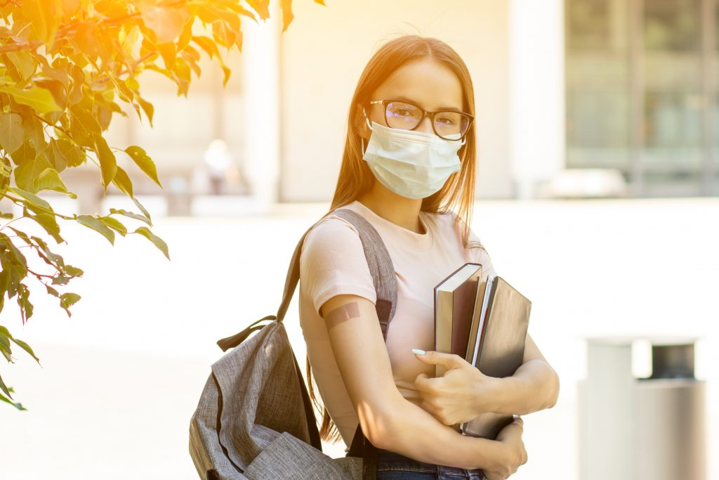Vaccination covid-19 in schools and colleges, Vaccinated students back to school after coronavirus pandemic over, returning to study after the summer holidays
